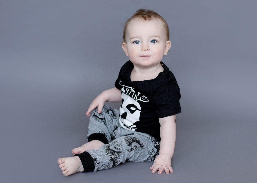 Little rocker baby in a studio