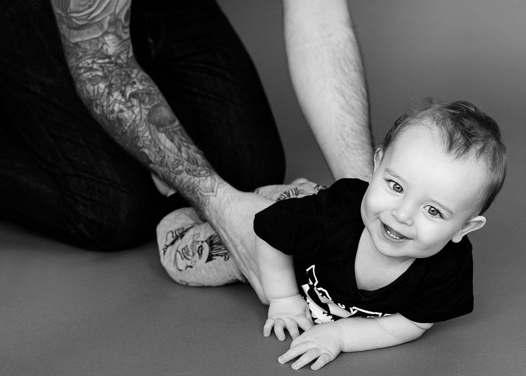 gorgeous little boy being held by dad