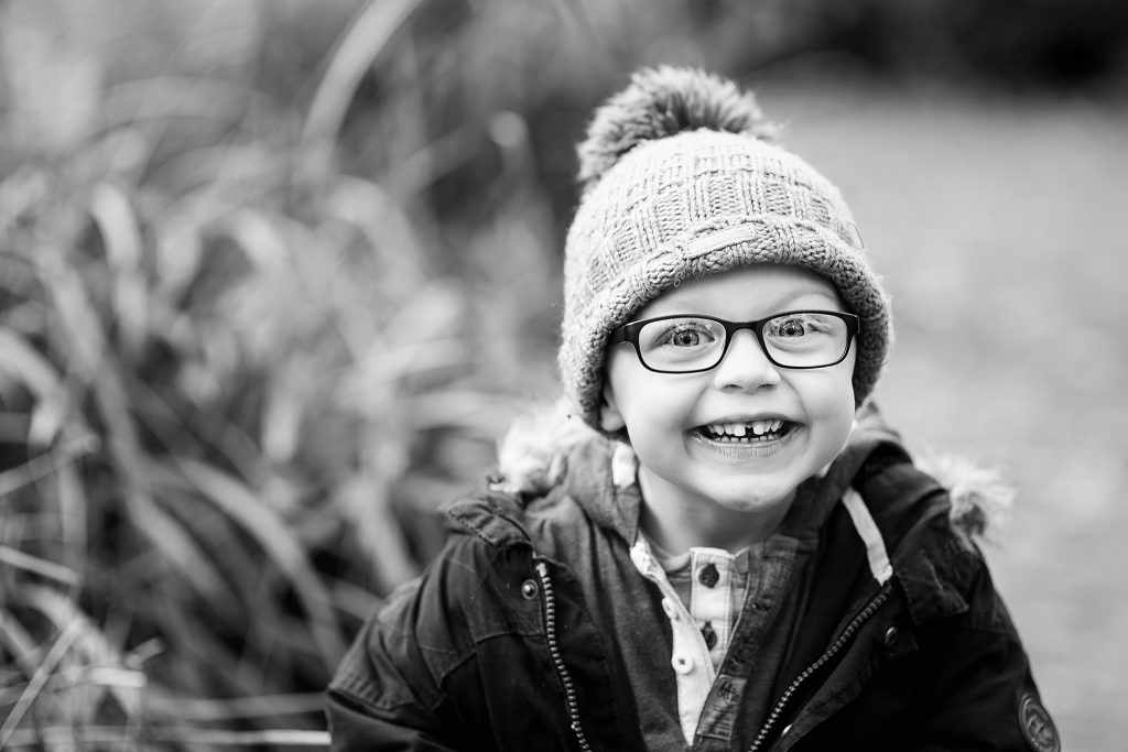 Woolly hat on a lovely little boy looking directly in the lens