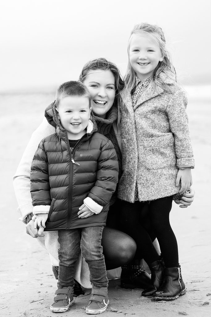 on the beach family photo professionally taken by Kelly McCambley