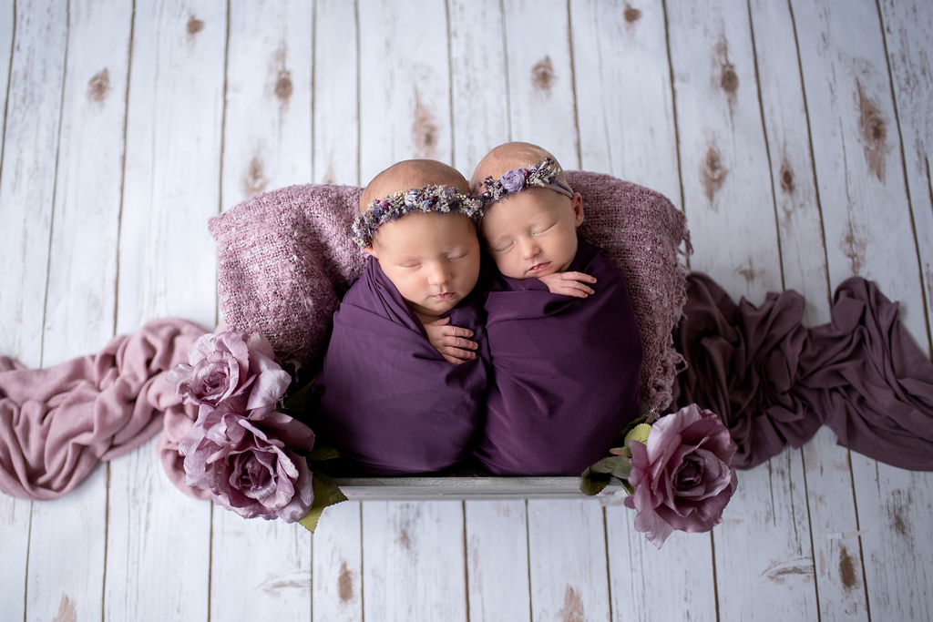 twin babies sleeping in purple