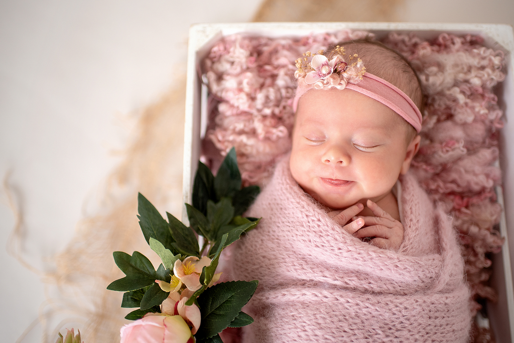 sleeping baby with a stunning pink floral headband