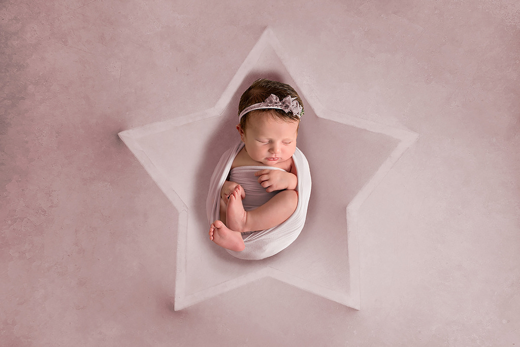 little baby girl in a star