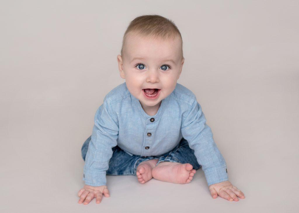 Little baby boy in blue denim clothes